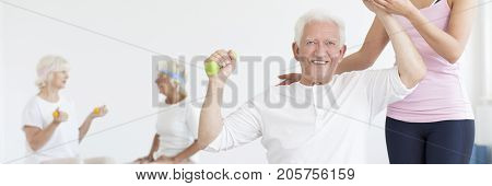 Senior Working Out With Trainer