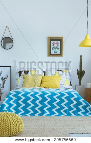 Bed With Blue Patterned Coverlet