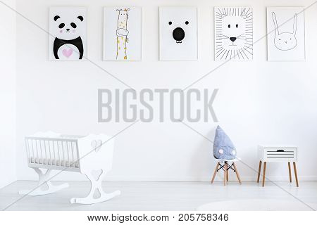 White Baby's Bedroom With Posters