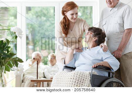 Caregiver Holding Lady's Shoulders