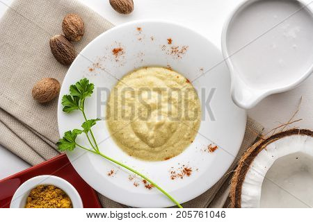 Coconut milk sauce with nutmeg top view