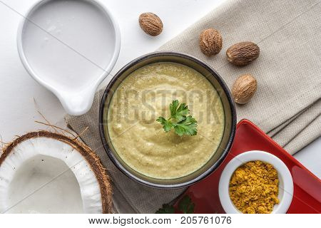 Coconut sauce with nutmeg and curry top view
