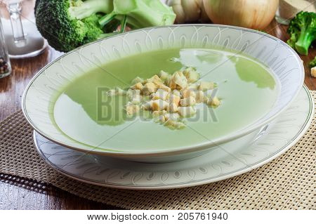 Broccoli Cream Soup In Plate Served With Croutons