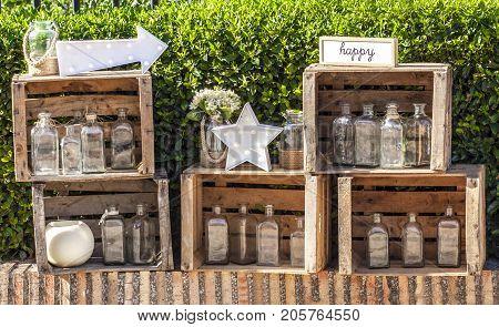 Set of old vegetables wooden boxes over garden background. Vintage decoration for weddings