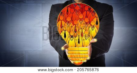 Unrecognizable corporate manager offering a virtual talent pool shaped like a light bulb filled with employee icons. HR concept for team building teamwork staffing solution and skilled workforce.