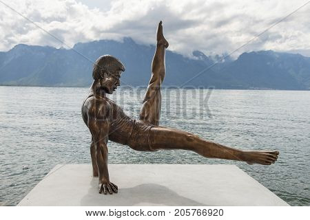 MONTREUX, SWITZERLAND - September 06: modern statue of china's gymnastic Li Ning  on the shores of Lake Geneva in Montreux, Switzerland on September 06, 2017