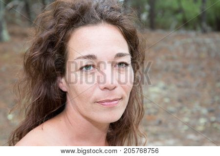 Portrait Of Forties Cute Woman In Sand Beach In Summer Day