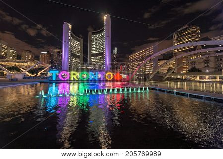 Toronto City Hall and Toronto Sign in downtown at night, in Toronto, Ontario, Canada
