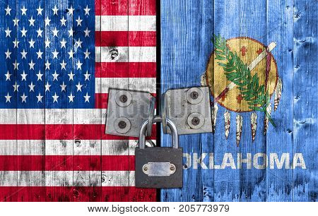 US and Oklahoma flag on door with padlock