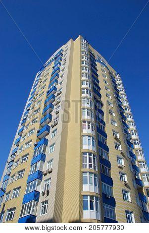 Modern multi-storey residential building against the blue sky