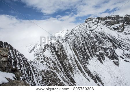 Picture of snow capped mountain range in the Arethusa Cirque in Kananaskis, Alberta,Canada.
