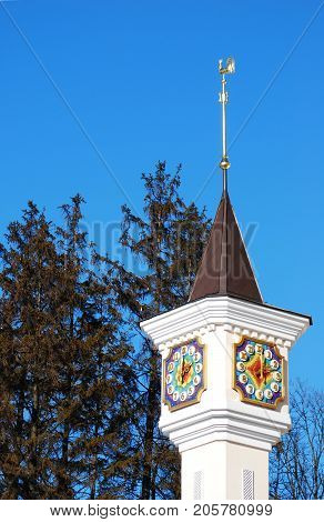 The clock tower and the weather vane with the figure of the golden cock