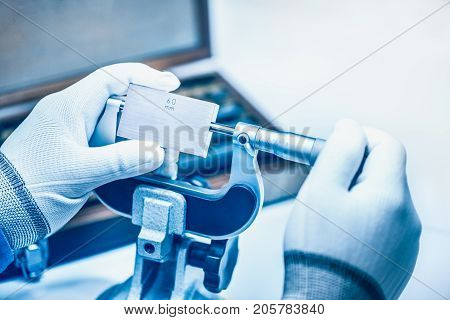 Micrometer Calibration with gauge block in laboratory.