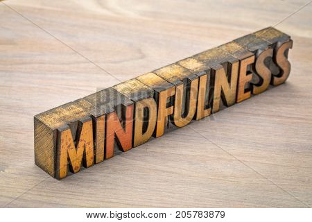 mindfulness word abstract  or banner - awareness concept - text in vintage letterpress wood type printing blocks against grained wood