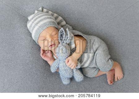 sleeping newborn boy with a hare