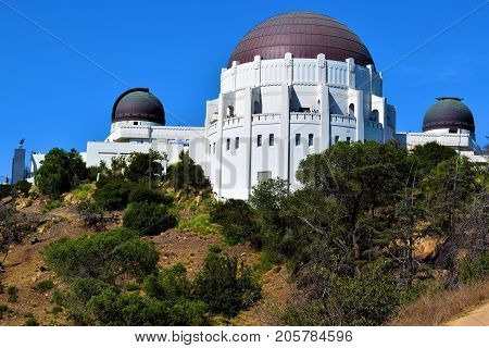 September 25, 2017 in Los Angeles, CA:  Griffith Park Observatory which is a historical landmark and opened in 1935 to the public taken at Griffith Park where tourists can enjoy astronomy exhibits including giant telescopes and planetarium shows