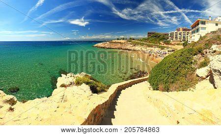 Salou resort town coastline on a sunny summer day. Spanish resort landscape. Typical resort town on the Mediterranean sea coastline.