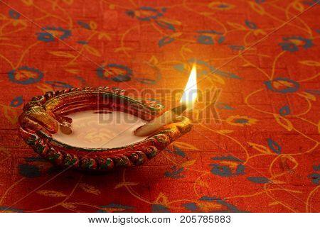 Indian Festival Diwali Diya Lamp Light on Red Background
