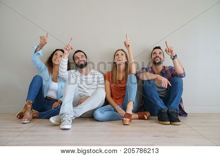 Friends pointing up at message, isolated