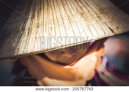 woman wearing traditonal vietnamese hat