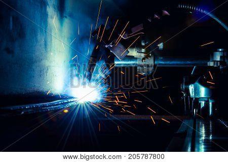 Flux Cored Arc Welding semi automation machine weld inside steel structure weld repair in fabrication factory.