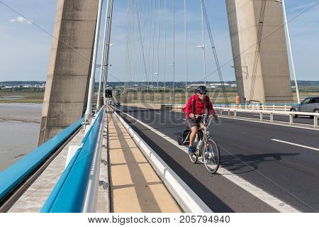 LE HAVRE FRANCE - AUGUST 24 2017: Cyclist at Pont de Normandie French bridge over river Seine near Le Havre and Honfleur