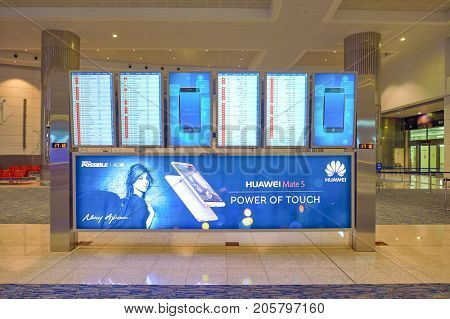DUBAI, UAE - CIRCA NOVEMBER, 2015: flight schedule display at Dubai International Airport. It is the world's busiest airport by international passenger traffic.