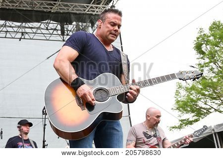 Troy Gentry of Montgomery Gentry performs onstage during the ACM Party For A Cause Festival at Globe Life Park in Arlington on April 17, 2015 in Arlington, Texas.