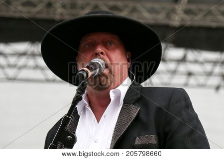 Eddie Montgomery of Montgomery Gentry performs onstage during the ACM Party For A Cause Festival at Globe Life Park in Arlington on April 17, 2015 in Arlington, Texas.