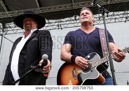 Eddie Montgomery (L) and Troy Gentry of Montgomery Gentry performs onstage during the ACM Party For A Cause Festival at Globe Life Park in Arlington on April 17, 2015 in Arlington, Texas.