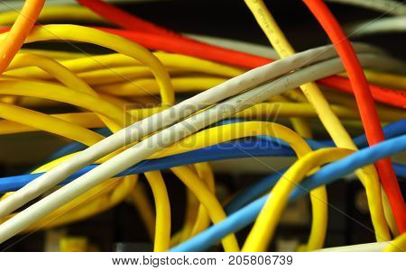 Many of colorful tangled ethernet computer wires