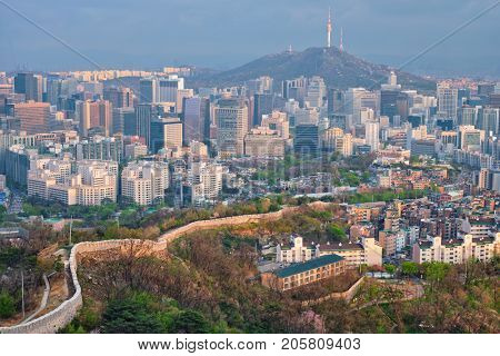 Aerial view of Seoul downtown cityscape and Namsan Seoul Tower on sunset from Inwang mountain. Seoul, South Korea. poster