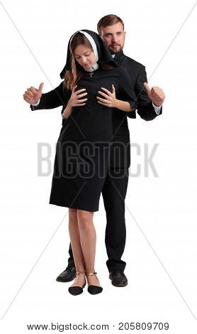 Sexy nun and handsome priest together. Dirty games of a nun and a priest. Full length of happy couple. Religions concept.