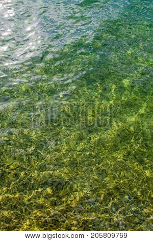Vertical up view of crystal transparent fresh river, sea water