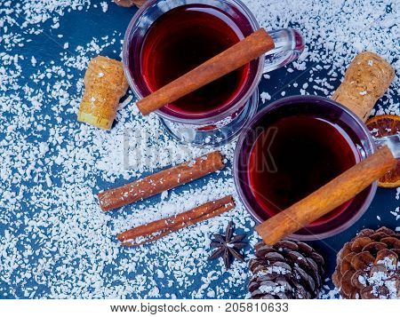 Frame Of Mandarines And Twigs Tree With Two Glasses Of Hot Mulled Wine With Oranges And Spices. Xmas