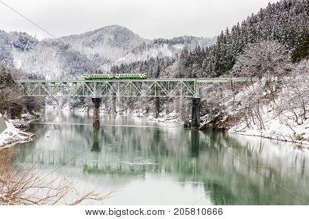 Train in Winter landscape snow on bridge panorama