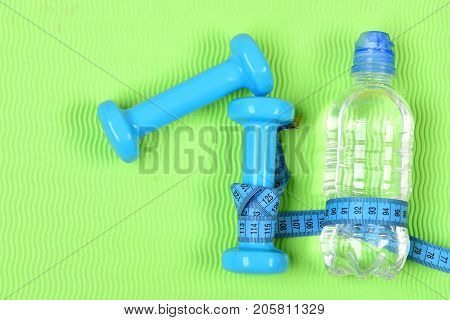 Barbells And Water Bottle Tied Around With Tape