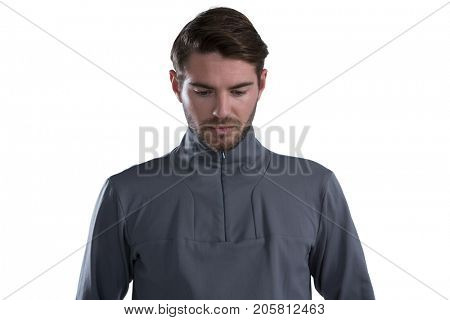 Man looking down against white background