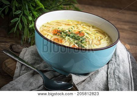 Broth - Chicken Soup In A Blue Bowl.