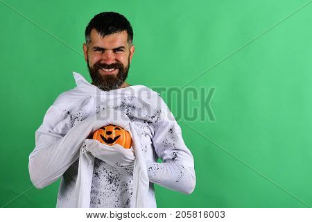 Man With Smiling Face Expression On Green Background Copy Space