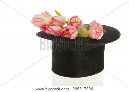 Black silk top hat with bouquet pink tulips isolated over white background