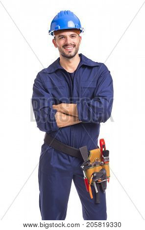 Portrait of a smiling young worker standing with arms crossed on white background