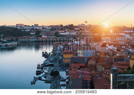 Top view of the Douro river and Ribeira rooftops from Dom Luis I bridge, Porto, Portugal.