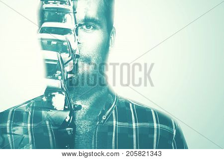 Double Exposure Portrait of a young man combined with a photograph of a city street and cars.Time and Traffic concept