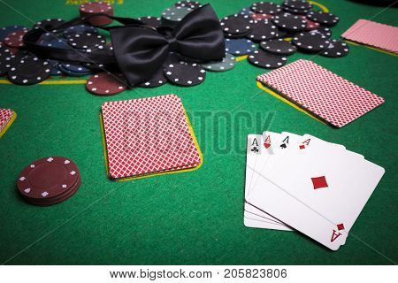 Cards and poker chips from above on green poker table