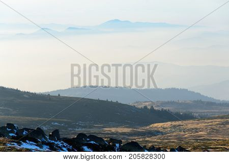 Fantasy mountain landscape of mountain peak floating above the clouds and vast expanse meadow