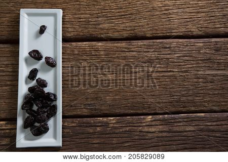 Date palms in a tray on wooden table