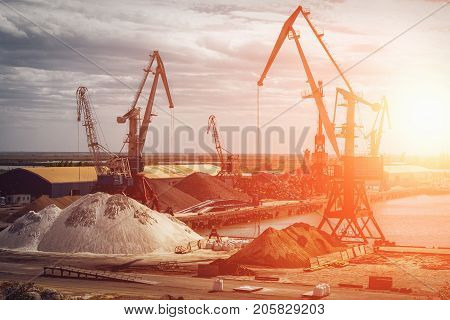 Industrial landscape with gantry cranes at sunset, unloading place in the port, toned