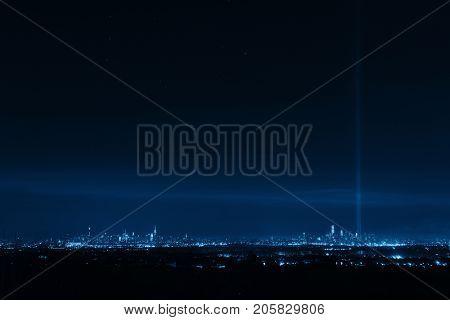 New York City skyline at night and September 11 tribute light
