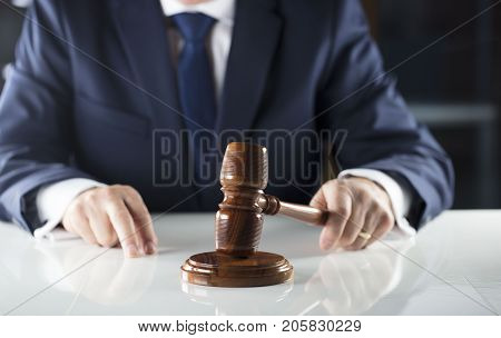 Auction and business concept.  Court executive oficer during judicial sale.